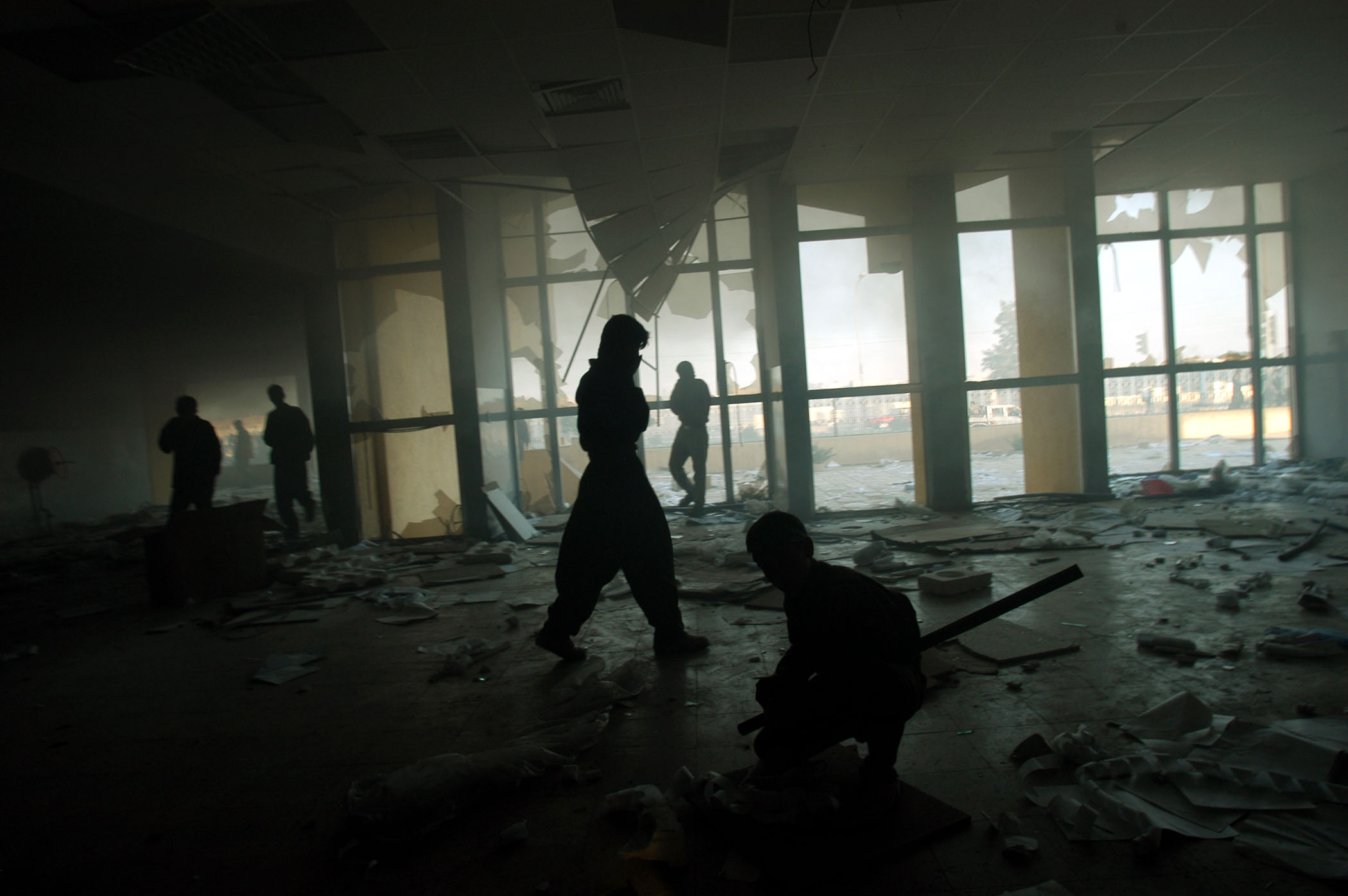 Iraqi Kurds loot merchandise from an abandoned supermarket in Kirkuk hours after it fell from Iraq Central Government rule, April 10, 2003.  Roughly twenty days after the start of the US-lead war on the regime of former Iraq leader Saddam Hussain, cities are falling out of his control, and locals celebrate and destroy statues and symbols of Hussains powerand Kurds from Norhtern Iraq have been looting abandoned homes, government buildings, and stores .