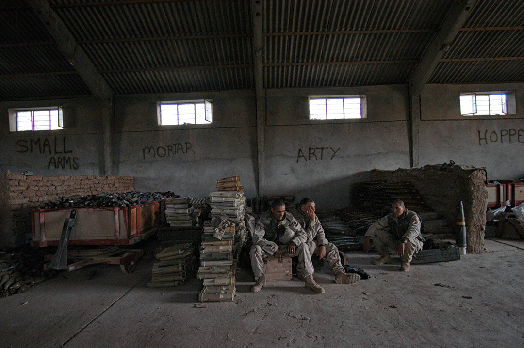 United States troops guard artillery and weapons collected after the fall of Iraqi leader Saddam Hussein in the Division Main Headquarters in one of Saddam Hussain's former palaces in Mosel, Northern Iraq, May 1, 2003.  The palace was Hussain's Northernmost palace in Iraq, and was his VIP palace, and now runs the entire northwest region of Iraq for the 101st Airbourne.