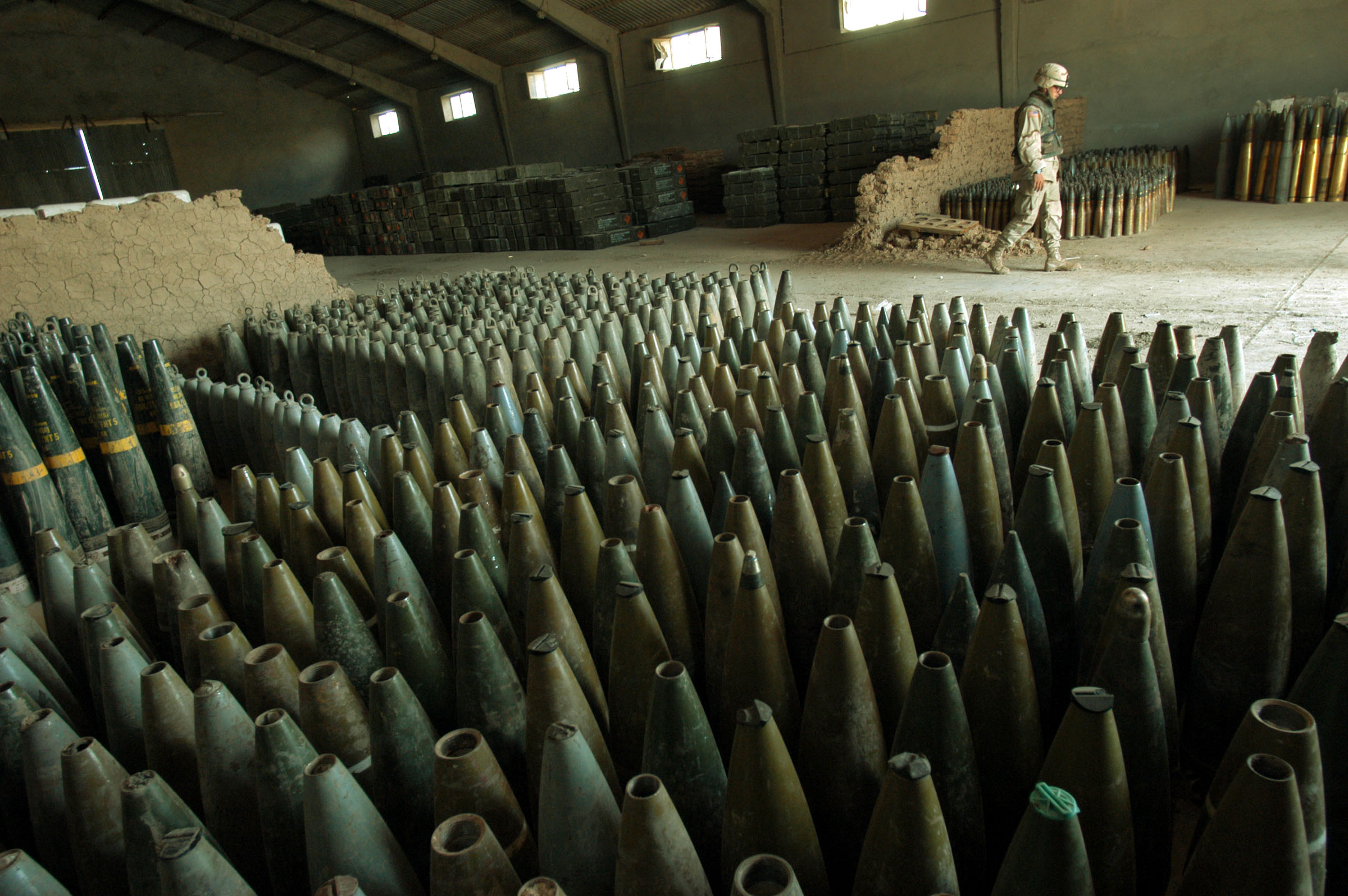 MajorTray Cate with the 101st Airbourne walks through a warehouse of ammunitions and mortar rounds in a depot of ammunitions and weapons found around the city of Mosel on a former Iraqi MIlitary site that the US troops has designated for recovered ammunitions and weapons, in Mosel, Northern Iraq, April 30, 2003. Since the fall of Saddam Hussain's regime in Iraq, hundreds of homes and makeshift depots like these, and with cahches of arms and ammunitions, have been found throughout the country.