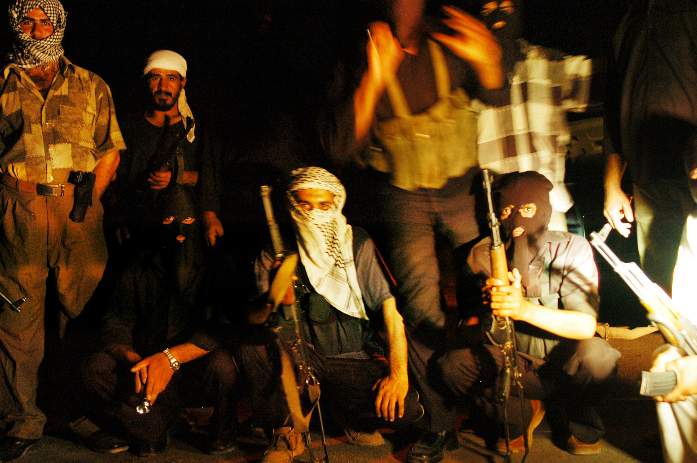 Members of the Mahdi Army pose for a picture while on a night patrol through Sadr City after midnight, July 25, 2004.   Since the handover to Iraqi sovereignty, militias like the mahdi army are quietly being used by the administration in coalition with government police forces to help stablilize troubled and crime-ridden areas throughout the country.
