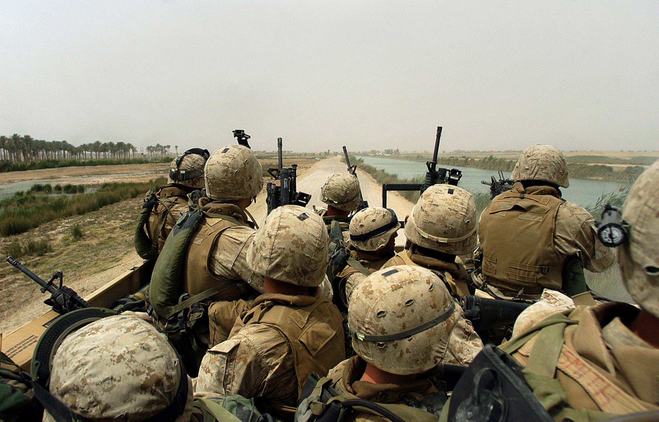 A squad of U.S. marines rides a 7-ton truck after being ambushed several times by insurgents while on a 'movement-to-contact mission in order to flush out insurgents operating in the Fallujah area  south of Fallujah on Thursday, April 15, 2004 in Iraq.  The marines are part of the 3rd Battalion, 4th marine regiment, which saw heavy combat at the beginning of the war last year, and is now back in Iraq embroiled in intense fighting with the resistance.  Today, the men of the 3rd Battalion were ambushed half a dozen times while they patrolled the palm groves and wheat fields around Fallujah, and the marines killed at least 10 insurgents, and suffered only minor injuries.