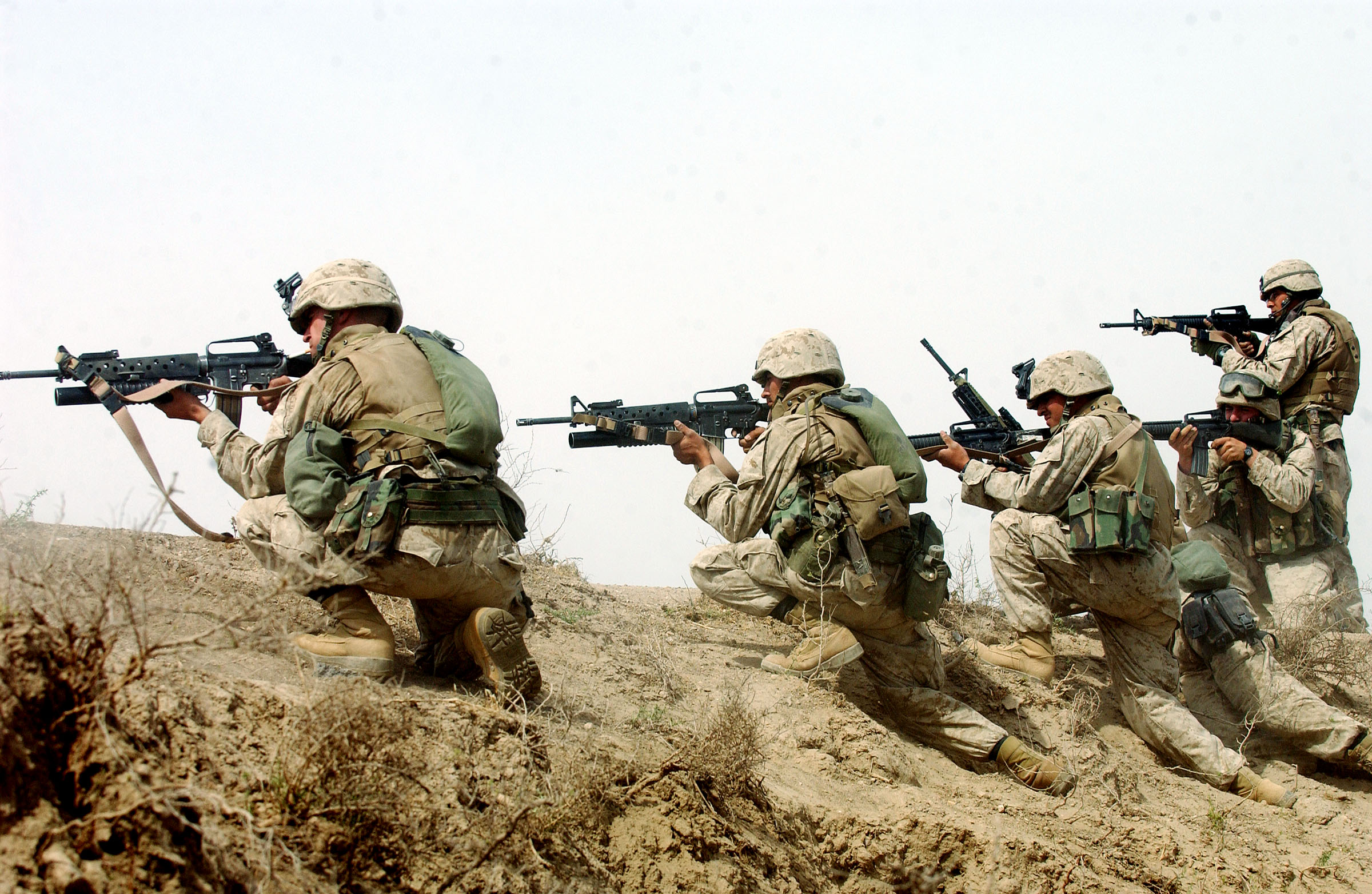 U.S. marines fire on a group of insurgents shortly after they launched a rocket propelled grenade at their 7-ton truck while on a 'movement-to-contact mission in order to flush out insurgents operating in the Fallujah area  south of Fallujah on Thursday, April 15, 2004 in Iraq.  The marines are part of the 3rd Battalion, 4th marine regiment, which saw heavy combat at the beginning of the war last year, and is now back in Iraq embroiled in intense fighting with the resistance.  Today, the men of the 3rd Battalion were ambushed half a dozen times while they patrolled the palm groves and wheat fields around fallujah, and the marines killed at least 10 insurgents, and suffered only minor injuries.