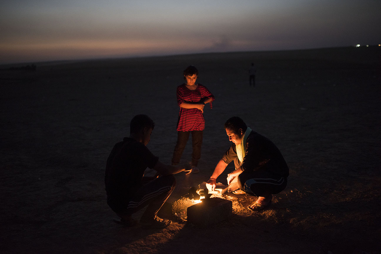 Khadir Elias, 25, makes a fire at dusk along with other Iraqi Yazidis who were displaced from their homes in early August as fighters with the Islamic State swept through their villages live in a makeshift camp at Khanke, in Northern Iraq, August 20, 2014. Elias fled his village of Hardan when ISIS came and arrested roughly 450 people from his village, including 37 relatives from his extended family, alone.   Since fighters with the Islamic State started pushing through Iraq and murdering and terrorizing thousands of civilians, almost one million Iraqis have been displaced from their homes across the country.