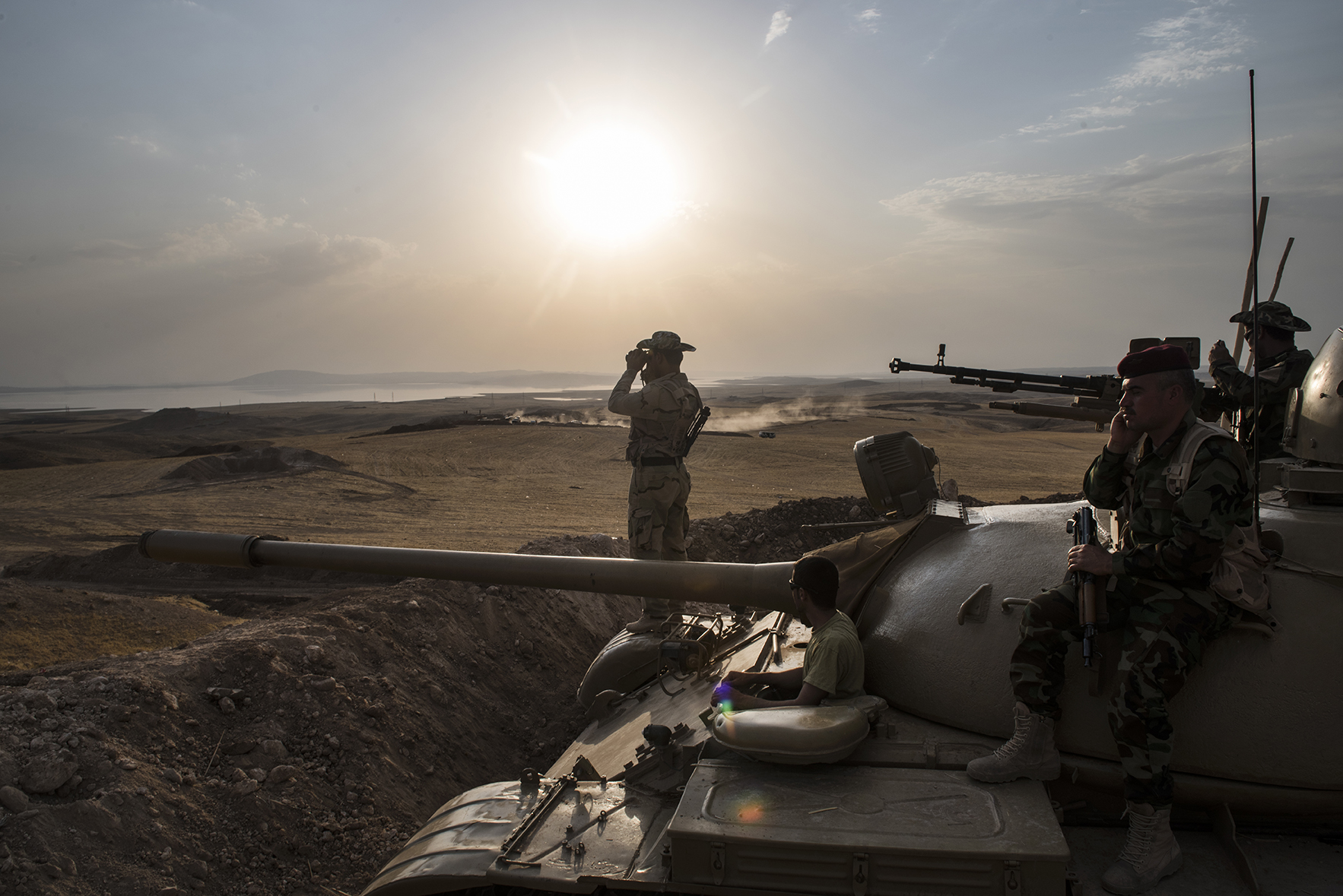 Kurdish Peshmerga forces stand in overwatch positions near the Mosul Dam in Northern Iraq, August 18, 2014. Iraqi officials said on Monday that Kurdish and Iraqi forces were on the verge of reclaiming control of the strategic Mosul Dam from the Sunni militants who seized it two weeks ago.  The American military is helping fight IS with targeted airstrikes on IS positions near the Mosul Dam, and Peshmerga are fighting on the ground.