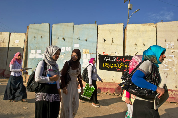 Notebooks in hand, young women head to class at the University of Baghdad, passing blast walls plastered with political posters. More than half the 70,000 students are female. The school closed briefly in 2006, after a rash of killings and kidnappings targeted academics.