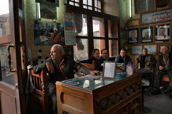 Seated near the entrance of the Shahbandar literary café, owner Haji Mohammed al Khashali gazes out to Al Mutanabbi Street, a centuries-old hub for booksellers and intellectuals. A 2007 car bomb near the café killed five of Khashali's sons, whose portraits hang on the wall.