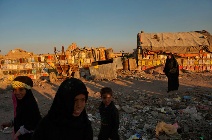 Shiites who fled sectarian violence near their villages have found safety and shelter in a garbage-strewn slum north of Baghdad. The Office of the United Nations High Commissioner for Refugees estimates that 1.5 million Iraqis remain internally displaced, many living in what it describes as {quote}deplorable conditions.{quote}