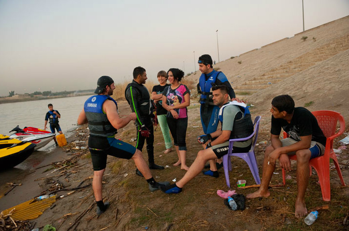 Young thrill seekers don wet suits and get ready to jet ski on the Tigris River.