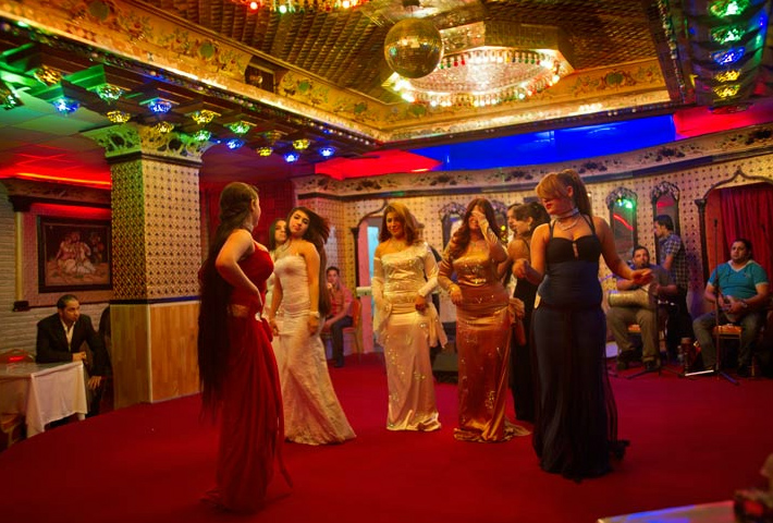 Dancers perform for male patrons at a nightclub in Baghdad. Some clubs that opened during Saddam Hussein's rule have since been closed by the authorities in response to complaints that they offend Islamic beliefs.