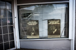 Posters are seen in a window in downtown Jackson, Miss., May 31, 2012.