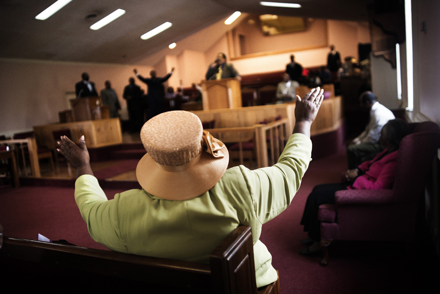 A woman is seen at a religious service in Mississippi. Often linked to poverty and unemployment, the state has some of the highest rates of diabetes, obesity, infant mortality and AIDS in the United States.