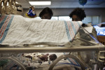 Teara Coates, 21, touches her baby, Tayden Coates, in an incubator in the neonatal care unit four days after he was born at the University Mississippi Medical Center.