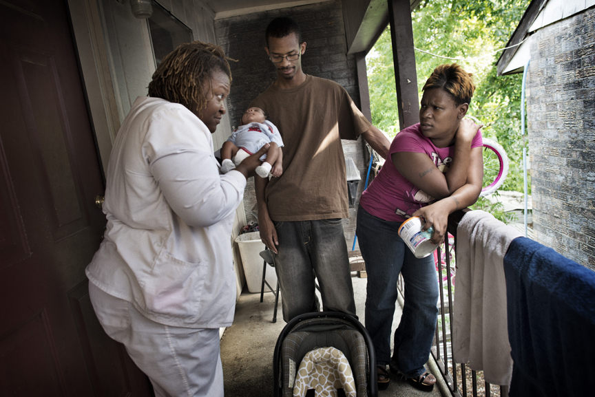 Home healthcare worker and Nurse Claudia Cox visits with Caralyn Brewster, 29, her boyfriend, Melvin McGee, 26, and their 8 week old baby, Justin McGee, who was born premature at 31 weeks in Jackson, Mississippi, due to Caralyn's high blood pressure.