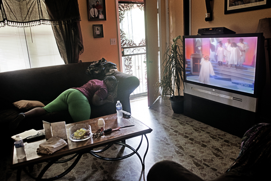 Tia Sturdevant, 15, watches 'A Different World' on TV at home as her mother lies ill with Diabetes and High Blood Pressure in the back room in Metcalf, in the Mississippi Delta, May 31, 2012.  Thousands of young adults like Tia suffer from obesity due to lack of exercize and poor diet, which often leads to Diabetes across Mississippi.