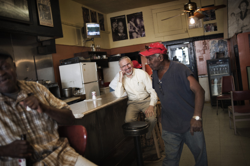 Dr.Mohammad Shabazi, an Iranian professor at Jackson State University, an historically-black college inJackson, Mississippi, is greeted by Luther Shelby Jr in Peaches Cafe in downtown Jackson, Mississippi, June 2, 2012.  Dr. Shabazi had moved to the States in the 80s for school andbecame fascinated by the US's health care problems, recognizing thesimilarities between the conditions in Mississippi and the conditionsunder which he grew up, as a member of a small nomadic tribe in Iran,and decided that Mississippi offered the best opportunity for hiswork.  He eventually teamed up with Dr. Aaron Shirley and non-profit consultant from Oxford, Mississippi, named James Miller, to try to implement a health care plan similar to that in Iran in Mississippi.  Mississippi has some of the highest rates of diabetes, obesity, infant mortality, AIDs, among other ailments, in the country, and though millions of federal funds have been thrown at the problems for years, conditions have only gotten worse.