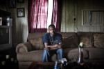 Joshua Alexander, 25, who is HIV+, sits at home in Greenville, in the Delta, mississippi, May 31, 2012.  Jordan is from Starkville, Miss, and had high blood pressure during her pregnancy, and delivered prematurely.