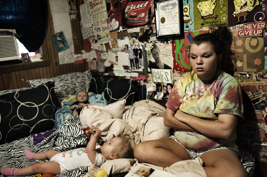 Maranda Corely, 19, sits in her bedroom with her three childrenin their bedroom in Ellisville, Mississippi, June 2, 2012.  Maranda got pregnant for the first time when she was 15, had twins that were born prematurely, and with serious disabilities, and four months ago, had a third child. Her aunt, Kelli Shoemake, 23, also has three children and lives in the same trailer.   Mississippi has some of the highest rates of diabetes, obesity, infant mortality, AIDs, among other ailments, in the country, and though millions of federal funds have been thrown at the problems for years, conditions have only gotten worse.