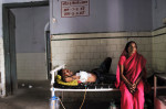 Sudama Rai, who has extra pulminary TB Plural effusion, sits with his wife, Daryapur Chapra in the general ward at the PMCH  Medical college in Patna, Bihar, India, August 13, 2010. Tuburculosis kills about 6,000 people each day, a number that is higher than AIDS or Malaria, the other two deadliest infectious diseases. In 2010, the World Health Organization estimates there will be ten million new TB cases, with at least a quarter of those in India.