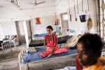 Ribha Kuwari, 14, from Jahanabad, sits ill with Tuburculosis in the female section of the ward for TB patients at the Nalanda Medical College in Patna, Bihar, India, August 10, 2010. Tuburculosis kills about 6,000 people each day, a number that is higher than AIDS or Malaria, the other two deadliest infectious diseases. In 2010, the World Health Organization estimates there will be ten million new TB cases, with at least a quarter of those in India.