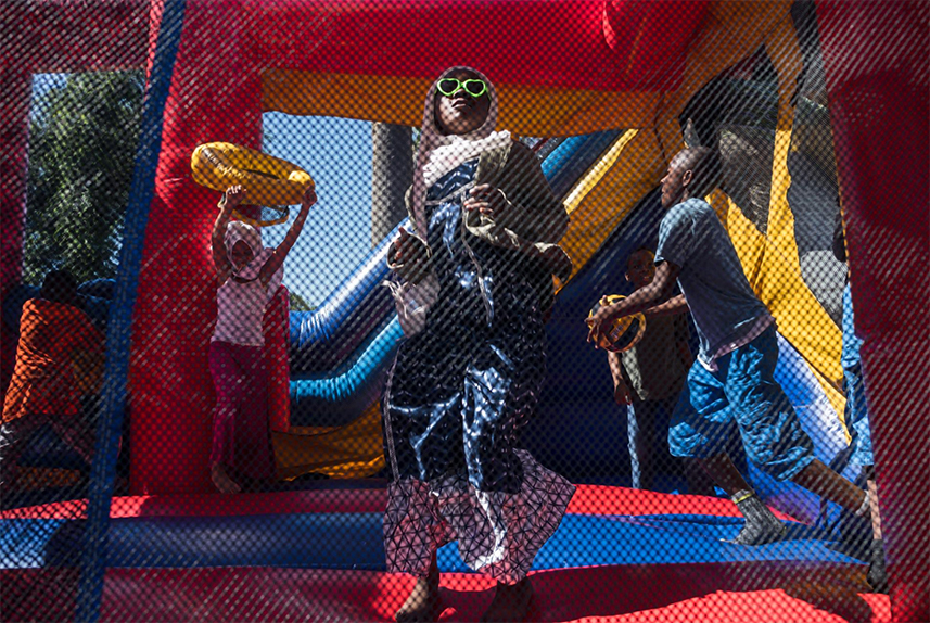 Children in South Los Angeles celebrate Eid al-Fitr, the holiday that marks the end of Ramadan, the holy month of fasting, at a picnic co-sponsored by Islah LA, a Black Muslim community center. Led by Imam Jihad Saafir, the center works to promote community, education, and social and economic empowerment.