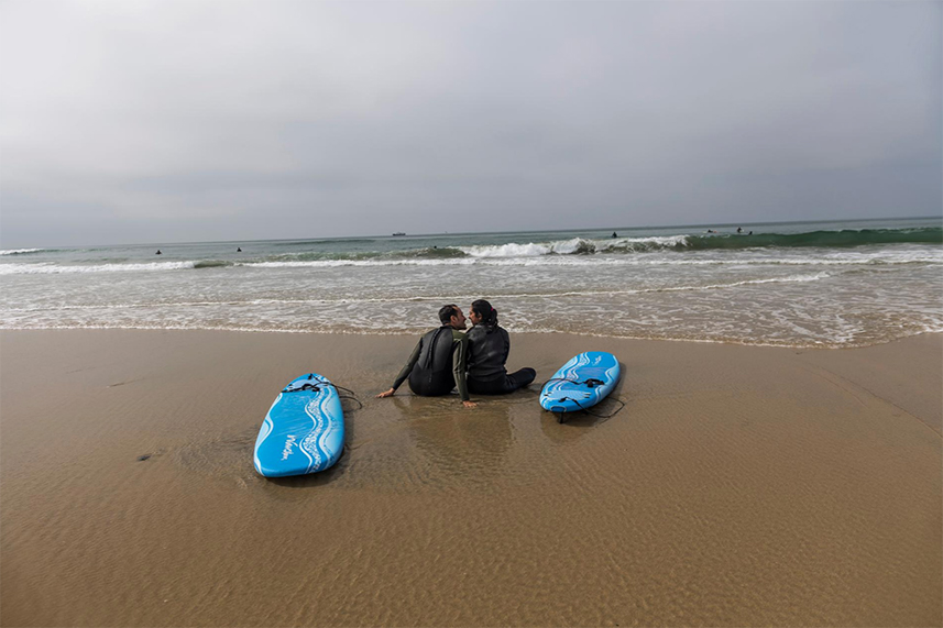 At Huntington Beach in Southern California, Yousef Turshani, a pediatrician, and Nadeah Vali, a lawyer, enjoy a moment to themselves. The married couple are among a group of Muslim friends who occasionally meet to surf.