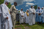 On the anniversary of Malcolm X's birthday, May 19, Muslims and non-Muslims make a pilgrimage to his grave at Ferncliff Cemetery in Hartsdale, New York, following traditions that evolved in the years after he was assassinated on February 21, 1965. Imam Al-Hajj Talib Abdur-Rashid from the Mosque of Islamic Brotherhood in Harlem presides over a prayer service for Muslims as the elder in the community.