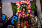 Ummey Ahmed, a Bangladeshi American, poses for photos at her family's home in Hamtramck, Michigan, after she and Tazer Khan (below) were married in a traditional Bengali wedding ceremony.