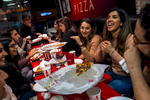 Young Afghan Americans enjoy a night out at Big Al's Pizzeria in Maywood, California, which specializes in halal beef and chicken toppings. The group—some of them friends, some meeting for the first time—was in the Los Angeles area to celebrate Nowruz, the Persian New Year, which falls on the spring equinox.