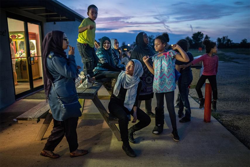 On an outing to the Showboat Drive-in Theater in Hockley, Texas, children from Centro Islamico in Houston wait while a parent buys them snacks. The mosque, which opened in 2016, serves Spanish-speaking Muslims.