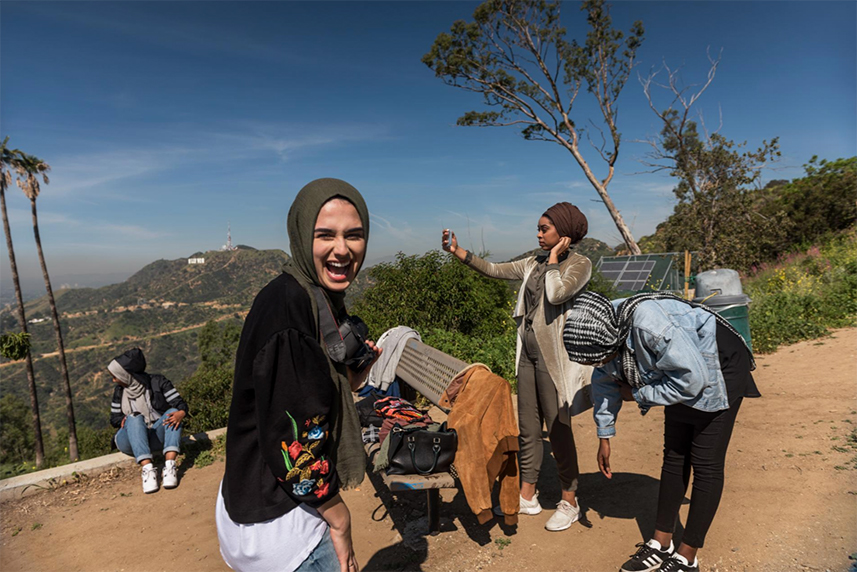 Marya Ayloush laughs as she oversees a fashion shoot in Los Angeles for her online hijab company, Austere Attire. Ayloush will use the photos to market her clothing on social media and her website. The business of creating modest fashion for religious women has taken off in the United States.