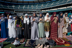 About 20,000 Muslims attended a morning prayer last year at Angel Stadium in Anaheim, California, to celebrate Eid al-Fitr. Muslims often dress up in their finest clothes on the holiday. The prayer marks the start of three days of celebrating and eating. In the U.S. the holiday is not typically recognized by employers or schools, so most Muslims must take time off to celebrate.