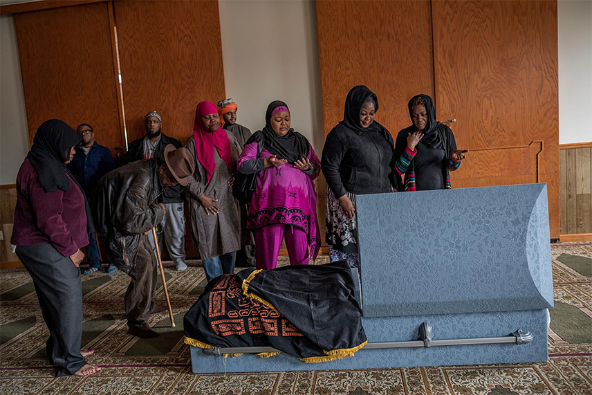 Relatives and friends of Jamil Ibn Rafael, who lived in Detroit, pay their respects at a mosque in Dearborn, Michigan, before his burial. Indigent and 66, he died of unknown causes. He converted to Islam when he was in his 20s. For his sisters (one at left, two at far right), who are Christian, it was their first time in a mosque.