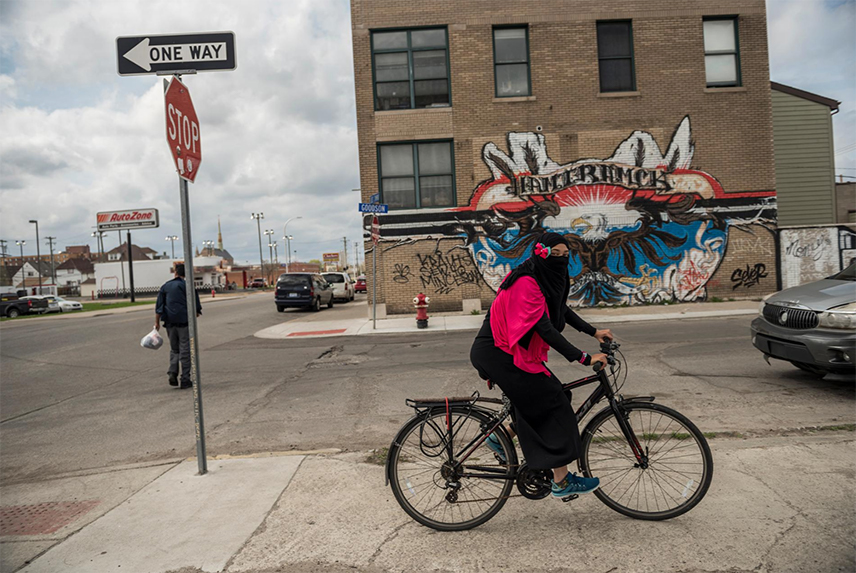 Lindsay Tukes, 25, whose Muslim name is Amiraldeen Alghazali, rides home from her class on the Quran in Hamtramck, Michigan. Hamtramck, a city surrounded by Detroit, became the first city in the United States with a Muslim-majority population. Muslims are also a majority on the city council. The city once attracted immigrants from Poland and eastern Europe. Today large populations of immigrants are from Bangladesh, Iraq, Yemen, Bosnia and Herzegovina, and African countries.