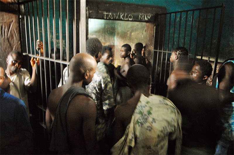 Prisoners walk around  the remand section of the Pedemba Road Prison in Freetown, Sierra Leone, November 23, 2006.  Dozens of suspected juveniles are mixed with adult prisoners in prisons throughout Africa, but because of a lack of birth certificates, it is difficult for officials to ascertain who are juveniles, and who are adults.