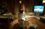 Prince Faisal bin Satam sends text messages from a friend's home in Riyadh, Saudi Arabia, 2003.
