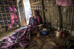 Sumeir, 35, is comforted by her daughter as she lies semi-conscious on the floor of her family's home a few days after surgery at the Sittwe hospital, outside of the Thay Chaung camp, Sittwe, Myanmar, November 24, 2015. For many years, Sumeir suffered from excruciating stomach pain. She went to the That Kay Pyin Emergency hospital within the IDP camp, and was referred to Sittwe hospital, outside of the camp. She was operated on a few days prior in Sittwe, and quickly discharged and returned to the IDP camp at Thay Chaung, allegedly without post-operative care, information about her condition, and without medication for healing.  She passed away the morning after this picture was taken.  An estimated one million stateless Rohingya have been stripped of their citizenship in Myanmar, and forced to live in modern-day concentration camps, surrounded by government military checkpoints.  They are not able to leave, to work outside the camps, do not have access to basic medical care, or food. Most aid groups are banned from entering or working in the camps, leaving the Rohingya to their own devices for sustenance and healthcare. Journalists are also routinely denied access to the Rohingya, Myanmar's way of ensuring the world doesn't see the slow, intentional demise of a population.