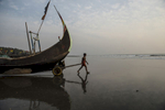Rohingya fishermen take their boats out to sea in Shamlapur Beach, outside of Cox's Bazaar, in Bangladesh, January 2016.  There are few professions available to the Rohingya, who are systematically marginalized, and forced into formal and makeshift camps across Bangladesh and Myanmar.