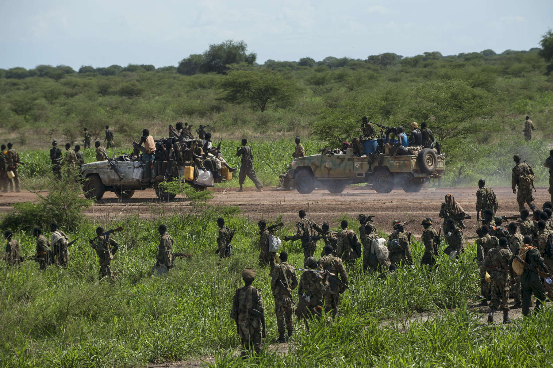 Soldiers with the Sudanese Peoples Liberation Army march towards the town of Bentiu in an effort to retake the town from rebel forces loyal to Riek Marchar only days after United States Secretary of State met with South Sudanese President Salva Kiir to try to broker an end to the fighting in the ongoing civil war in South Sudan, May 4, 2014.  One million Southern Sudanese have been displaced from their homes as the civil war rages in the country, pitting ethnic Nu'er against Dinka.  (Credit: Lynsey Addario for The New York Times)