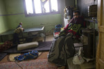 Hussein Mehio, a fighter with the Free Syrian Army who was wounded in battle in Aleppo, sits in the room he is living in with his two wives and children and other displaced people in a school in Soran, in Northern Aleppo Province, February 10, 2013.   Members of the town council of many of the villages in northern Aleppo province have been working hard to get the towns up and running again in the midst of the war, though they are struggling with a grave lack of resources. Thousands of Syrian families have been displaced from their homes, and are living in makeshift quarters within Syria, with little aid trickling across the border. Council members try to provide their bakeries with flour to make bread, and are working on providing water, electricity, and other facets of infrastructure, while also ensuring there is education for the children and a piecemeal security force.  While parts of Aleppo faces constant fighting between regime forces and the Free Syrian Army, there are villages that are trying to build a town council, and help return life back to some semblance of normalcy amidst the war.
