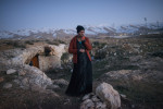 Dalal, 21, a Syrian refugee from the Damascus suburbs stands in front of the cave she and her family have been staying in since crossing into Lebanon roughly a week prior,  in Baalbak, Lebanon, January 22, 2013. Lebanon has been refusing to set up typical tent camps for refugees in the manner Turkey and Jordan have done, and so refugees are forced to live underneath commercial buildings, in makeshift tents, and with families around the country. The United Nations estimates that the number of Syrian refugees currently in countries bordering Syria has risen to 600,000, and there registered number of refugees in Lebanon, alone, is roughly 200,000.