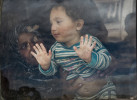 Sawsan Ibrahim, 24, holds her daughter, Aya, 16 months, up to the car window, the morning  after she and her husband, Mohammed Suleiman, 36, arrived in the Zaatari camp from Daraa, Syria to Jordan, April 7, 2013.  Roughly 100,000 Syrian refugees live in the camp, and more arrive each day desperately trying to flee ongoing violence across the country, crossing through official and unofficial border crossings between Syria and Jordan as the civil war in Syria enters its third year.   The United Nations estimates that the number of Syrian refugees in countries bordering Syria is currently over one million.