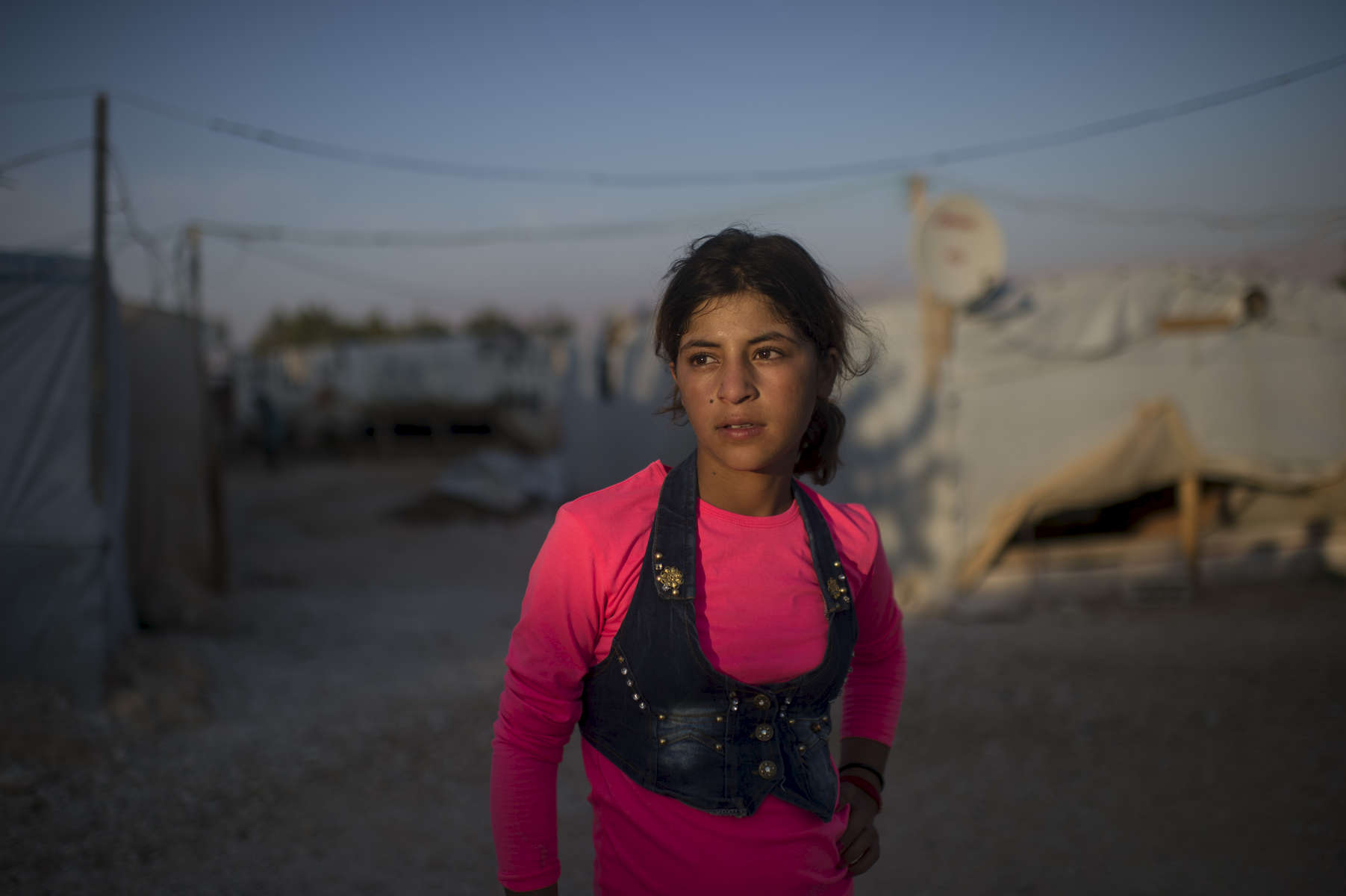 Hanaa Abdullah, 12, poses for a portrait in the informal tented settlement she lives in with her family and other Syrian refugees,in the Bekaa Valley, between the city of Zahle and Baalbak, in Lebanon, August 1, 2015.  Hanaa and her family fled Syria in 2011 at the beginning of the Syrian civil war, and moved to this settlement two years ago, along with other Syrian refugees from Hasaka and the surrounding areas. Hanaa and other children in the settlement work for up to ten hours a day in agricultural lands owned by Lebanese in the area, and earn the equivalent of $5. per day.