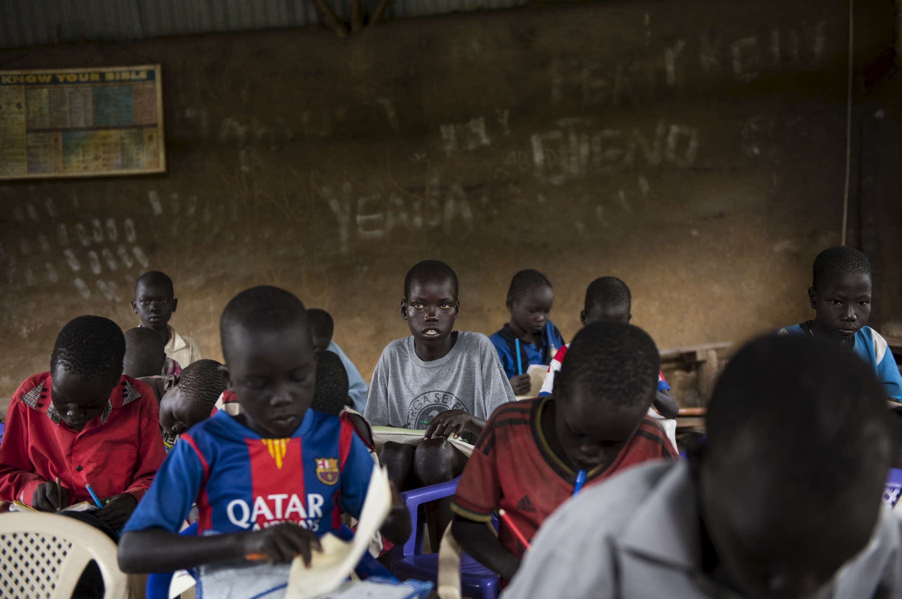 Chuol, 9, from southern Unity State, attends class with other internally displaced children and local villagers in a UNICEF-sponsored Child Friendly Space in Unity State, South Sudan, September 11, 2015.   Chuol was chased out of his own village with his grandmother and sister several months ago when it  was attacked, and his father and grandfather were burned alive. He, his grandmother, and sister fled to this area, where they are living on the ground of a host family. in South Sudan, September 11, 2015. Thousands of civilians have been killed, and others displaced since fighting between those loyal to President Salva Kiir and those loyal to opposition leader Riek Marchar began again in 2013.