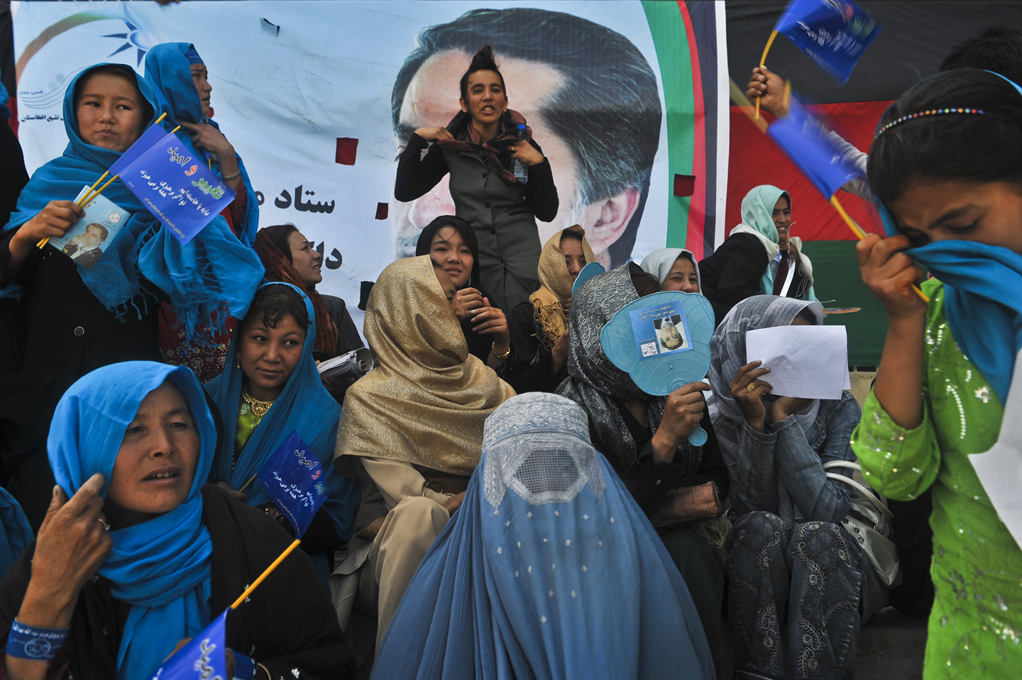 Presidential Dr. Abdullah Abdullah is surrounded by supporters at a rally in Kabul, Afghanistan, August 3, 2009.  The elders came to Dr. Abdullah to announce their support of his campaign for Presidency. As Afghans gear up to vote in presidential elections slated for August 20, the candidates are on the campaign trail.