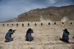 Afghan policewomen handle AMD-65 rifles at a dusty firing range outside Kabul. They are trained by carabinieri, Italian military police from the local NATO troops. Joining the police force is a bold decision for an Afghan woman. Insurgents often attack the police. Very few women get permission to sign up from their husband and male relatives. Of 100,000 officers, only about 700 are female. Yet women are welcome recruits. They can take on tasks that men cannot because of Islamic custom: frisking other women, searching homes where female family members are present. Many who take the job are widows of fallen officers cast in the role of breadwinner. The pay is about $165 a month.