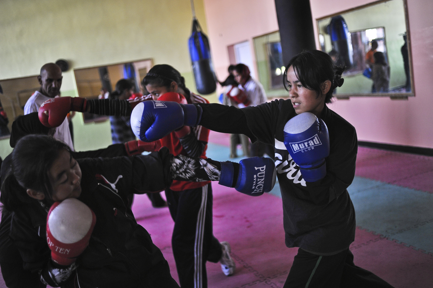 These young Afghan women are part of a team that will compete at the 2012 Summer Olympic Games in London, where women's boxing will debut as an official sport. The athletes triumphed just by getting their families to sign on to the idea of their daughters participating in sports. During matches in public venues, the members of the Oxfam-supported team, now competing in South Asia, cover their hair with hijab worn beneath their head guards. That's not a problem for the International Boxing Association, as long as the boxer's face is clearly visible. Here, practicing indoors in Kabul, they can go bareheaded.