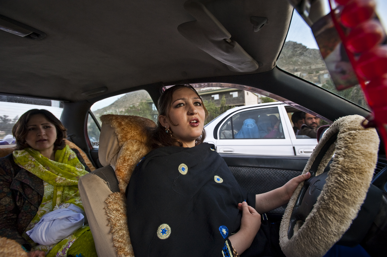 With face, hair, and arms in full view, actress Trena Amiri chauffeurs a friend around Kabul on a Friday. She blasts her favorite songs off a cassette and shimmies and sings along, tapping the steering wheel as she dances in the driver's seat. Even in relatively progressive Kabul, men and women glare, honk, and scream at her. It provokes men in Afghanistan to see strong women. It symbolizes a freedom they just aren't comfortable with. Amiri fled her husband of seven years, who, she says, kept her home and beat her. She left her three sons behind. She doesn't plan to remarry but knows she might have to in order to survive in Afghanistan, where women are dependent on men for so many things. When I ask about her current boyfriend, whose name is on the gold bracelet around her wrist, she says she couldn't marry him: {quote}He won't let me act anymore, and I want to continue my art.{quote}