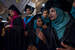Many girls in Afghanistan get no education at all. Even those who do enroll in a school typically study for just four years. So these members of Kabul University's class of 2010 are definitely in the minority. Wearing hijab under their mortarboards and seated in separate rows from their male peers, the women pictured are graduates of the department of language and literature. The Taliban had banned the education of women, but classes resumed after the regime fell in 2001. This graduation was held under tight security at a hotel in Kabul because of an upsurge in terrorist attacks.