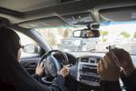 Aziz Yousef drives in Riyadh while Eman Nafjan films her for a driving video for the driving campaign in Riyadh, Saudi Arabia, March 20, 2015. Both women have been arrested and detained for the ongoing campaign against the driving ban for women in Saudi Arabia, and have had to sign official pledges that they will no longer drive. Aziza was born in 1959, and first got her US driving license in Virginia in 1981 where she owns a house and visits often, and most recently got a license in 2013.