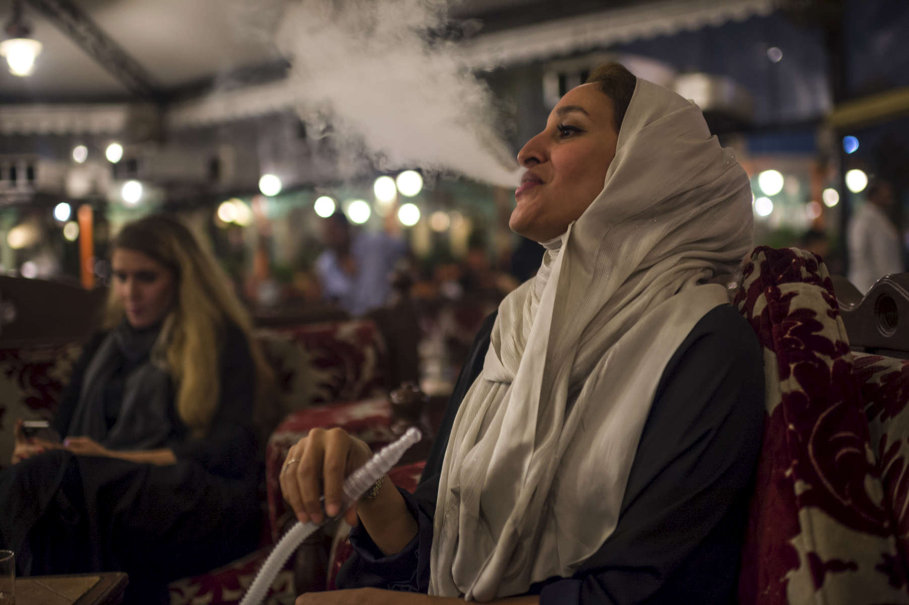 Saudi women smoke sheesha, a traditional Arabic water pipe in a cafe in Jeddah, Saudi Arabia, December 2014. Saudi women in the port city of Jeddah have traditionally been more open, and are permitted to smoke sheesha in public--something that is forbidden in most of the rest of the country.